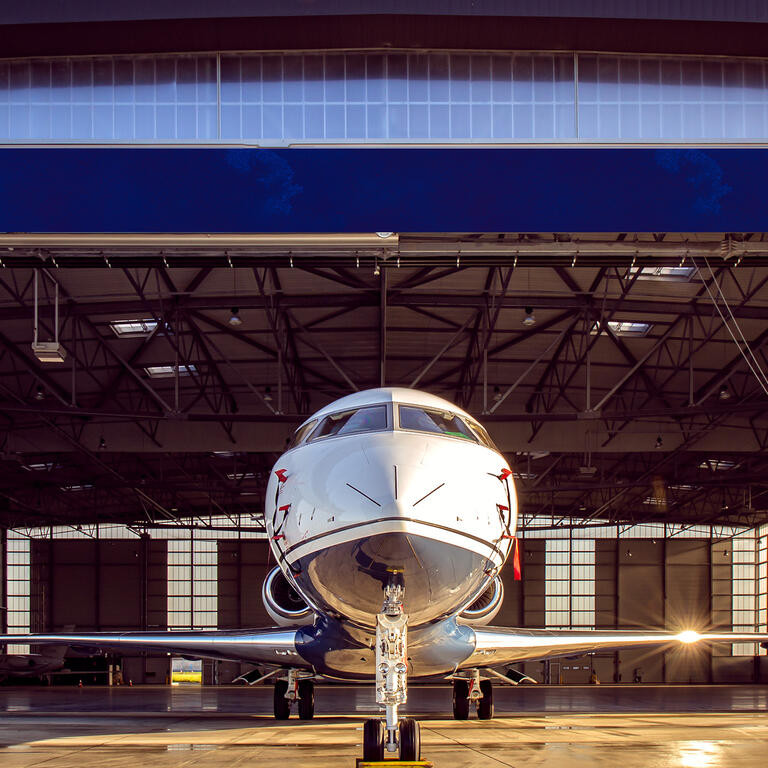 private jet at the exit of the warehouse