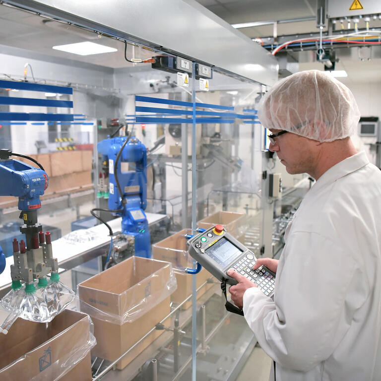 Workers in the pharmaceutical industry - production infusion bags