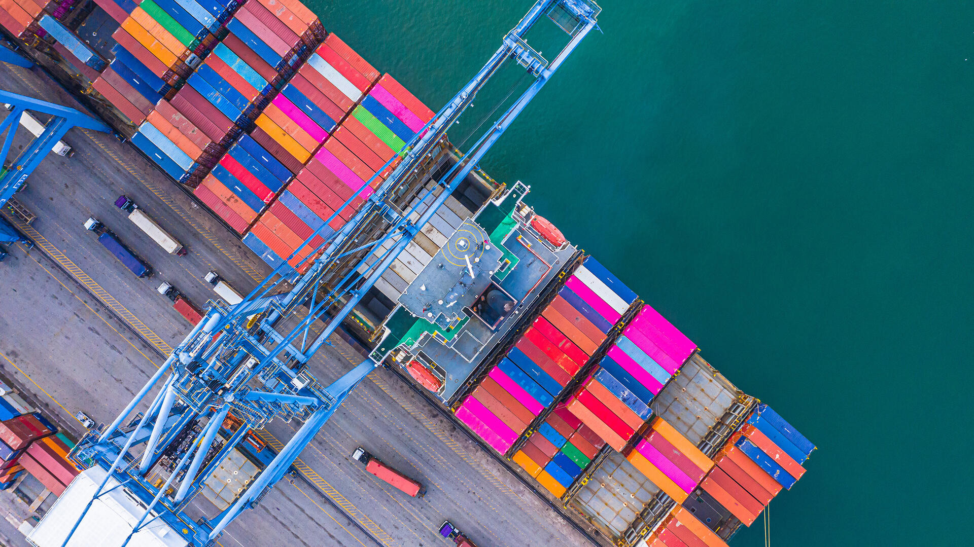 Container ship loading and unloading in deep sea port, Aerial top view of logistic import export transportation business by container ship in open sea